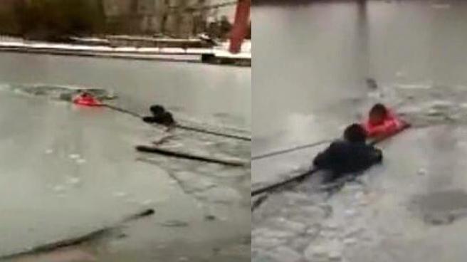 信阳:民警跳入冰窟 胳膊破冰勇救落水女童